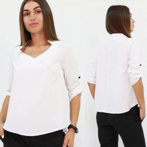 Стильна жіноча блузка вільного крою кольору біла